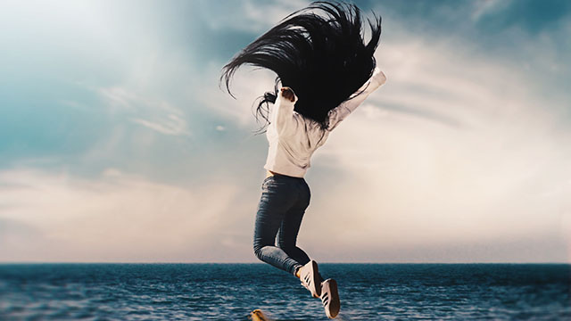 jumping-woman-full-of-energy